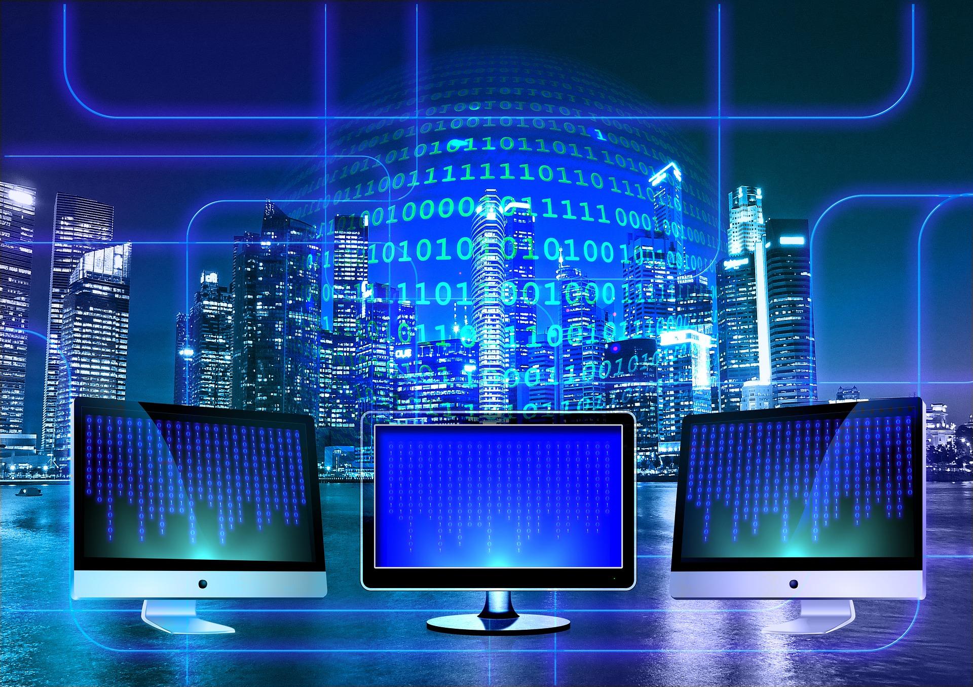 Imagem ilustrativa para o projeto Participact Brasil. São três computadores em frente a um globo